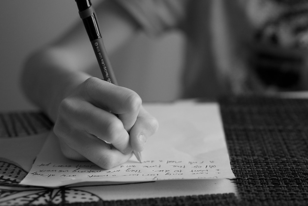 girl writing in black and white